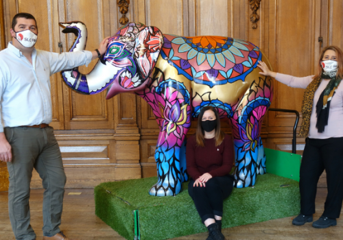 (L to R) Nathan Campsall, Director, SLC Rail, Sara Matthews, St Richard's Hospice, and Sam Uren, Engineering Director, SLC Rail, pictured with Sundar the elephant. Image taken before November 2020 lockdown commenced.